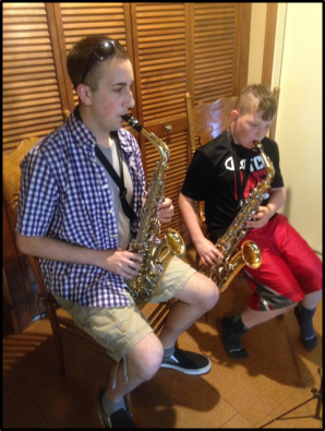 With an alto sax student. This champ has been working on advanced music by Haydn, Mozart, and Beethoven as part of the Classical portion of our Historical Perspectives unit!