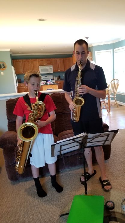 With a bari/alto sax student. Exploring the depths of the new horn!